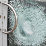 smashed glass entry door